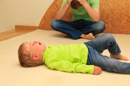 A child having a tantrum on the floor